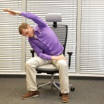 man exercising on chair in office, healthy lifestyle - front view